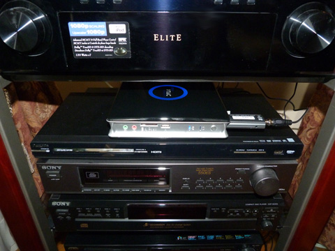 The ZBOX sitting on the entertainment center